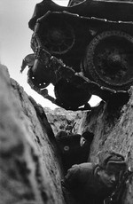 Soviet infantrymen in a trench while a T-34 tank passed over them, date unknown