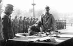 Lieutenant General Ginnosuke Uchida surrendering his forces to the Chinese, former French Concession zone, Tianjin, China, 7 Oct 1945; the surrender document was accepted by USMC Major General Keller Rockey on behalf of the Chinese