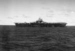 Port side view of the USS Bunker Hill while at sea off the Palau Islands, 27 Mar 1944. Note the Measure 32, Design 6A paint scheme, only two carriers were painted this way.