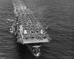 Replacement aircraft for Espiritu Santo crowd the flight deck of the Escort Carrier USS Kwajalein as she steams from San Pedro, California, United States, 19 Jul 1944