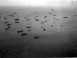 "US Navy ships at anchor in the Ulithi Lagoon, Caroline Islands, early Dec 1944. Note that this is a reverse angle and distant view of the ships in the famous ""Murderers' Row"" photograph but a day or two earlier."