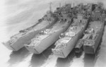 Japanese Navy landing ships No. 150, No. 101, No. 127, and No. 149 at Kure Naval Arsenal, Japan, 13 Mar 1944
