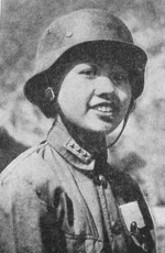 Portrait of one of the about 300 female conscripts from Guangdong Province, China, 1938; these young women underwent 3 months of military training as the Japanese advanced toward Guangdong