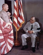 President Franklin Roosevelt being presented with a Japanese flag captured by US Marines on Makin Island by Marine Corps Commandant LtGen Thomas Holcomb, White House, Washington DC, 17 Sep 1942.
