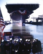 USS Franklin being floated out of drydock for the first time, Newport News, Virginia, United States, 14 Oct 1943. Note Navy WAVES on the dock; WAVES