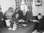 Chief Air Marshall Sir Arthur Tedder and LtGen Carl Spaatz in the office of Marshall Georgy Zhukov before the German surrender was signed at Zhukov's Headquarters at Karlshorst, Berlin, Germany, 7 May 1945