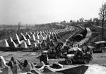Soldiers of the US 7th Army pause at the Siegfried Line on the road to Karlsruhe, Germany, 27 Mar 1945