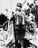 Chinese soldier displaying captured Japanese equipment, Tai