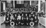 Group portrait of the crew of USS Burrfish, 1943; note commanding officer Lt Cdr William Beckwith Perkins, Jr. front row center and Page Newman Perkins (née Rudd) behind him