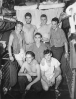 US Navy submariners, 1943-1945; they were likely crewmembers of USS Billfish, USS Bowfin, or USS Burrfish; note Frederick B. Meek, Jr. in rear row with cigarette