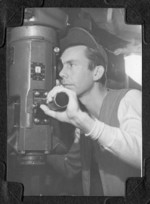 Crewman at the periscope of USS Burrfish, 1943-1945