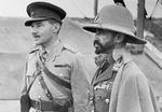 Abyssinian leader Haile Selassie with a British interpreter during an inspection of an airfield in eastern Africa, 19 Feb 1941.