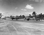 B-25 Mitchell bombers of the 42nd Bomb Group on the ramp at Munda, New Georgia, Solomons, 1943. Note B-24 Liberator nose turrets at left.