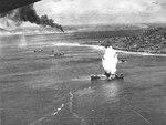 Japanese freighter at Truk, Caroline Islands hit by a torpedo dropped from a US Navy squadron VT-10 Avenger aircraft, 17 Feb 1944, photo 2 of 2