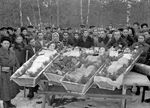 Burial service of two Jewish and two Russian resistance fighters of the Molotava Brigade, near Pinsk, Poland (now in Belarus), 1944