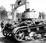 A destroyed T-26 tank surrounded by dead Red Army soldiers near the German-Soviet border in occupied Poland, late Jun 1941