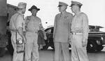 Lieutenant Colonel Paul Jones, General Joseph Stilwell, Major General Patrick Hurley, and Major General Daniel Sultan awaiting for a flight to Chongqing, China at an airfield in New Delhi, India, Sep 1944