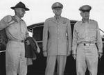 General Joseph Stilwell, Major General Patrick Hurley, and Major General Daniel Sultan awaiting for a flight to Chongqing, China at the airport in New Delhi, India, Sep 1944