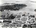 Aerial view of Boston Navy Yard, Boston, Massachusetts, United States, 1942; note frigate USS Constitution at left and Jeffrey Field (now Logan International Airport) in background