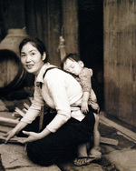 Mother and child, Sasebo, Japan, Sep 1945; photograph taken a crewman of USS Chenango