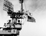 V-J flag and US flag being flown from USS Chenango while at Sasebo, Japan, Sep-Oct 1945