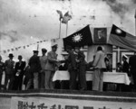 Major General D. L. Weart greeting General Tang Enbo during Double-Ten Day celebrations, Shanghai Race Course, Shanghai, China, 10 Oct 1945
