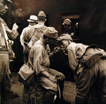 Demobilized Japanese soldiers at a train station in Hiroshima, Japan, Sep 1945