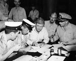Surrender signing at Mili Atoll, Marshall Islands, aboard USS Levy, 22 Aug 1945; L to R: LtCdr Hiroshi Tokuna, Mili commander Capt Masanori Shiga, Lt ER Harris, Lt Col GV Burnett, and Majuro Area Commander Capt HB Grow