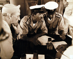 Surrender negotiations at Mili Atoll, Marshall Islands, aboard USS Levy, 19 Aug 1945; L to R: US Majuro commander Captain H. B. Grow, and Japanese representatives LtCdr Toyda and Lt Hutsu.