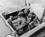 MGen George Patton and RAdm John Hall, US Navy (behind Patton – and, Yes, the Admiral has his helmet on backwards) prepare to go ashore at Fedhala, Morocco during the North African operation, 9 Nov 1942.