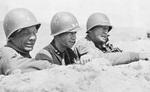 Brigadier General Theodore Roosevelt, Jr., Major General Terry Allen, and Lieutenant General George Patton observing the field near El Guettar, Tunisia, late Mar 1943