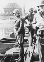 George Patton preparing to urinate in the Rhine River, Germany, 24 Mar 1945