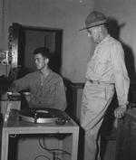 Lieutenant General Joseph Stilwell speaking to Coporal Jerry Givney at US Army radio station VU2Au, Calcutta, India, 30 Jul 1944