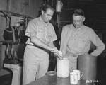 Corporal Abe Brandes serving Lieutenant General Joseph Stilwell ice cream at a US Army ice cream plant in Calcutta, India, 30 Jul 1944