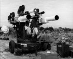 Leslie Elliott operating filming equipment mounted on a M45 Quadmount, Cape Canaveral, Florida, United States, date unknown