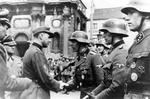 Léon Degrelle speaking to troops at Charleroi, Hainaut, Belgium, 1 Apr 1944; note Josef Dietrich in background