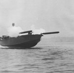 Elco 80-foot motor torpedo boat simultaneously launching two practice torpedoes during a training exercise in United States waters, 1942-44.