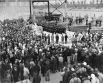 Commissioning ceremonies for Motor Torpedo Boat Squadron 16 (MTBRon 16) at Higgins Boatworks in New Orleans, Louisiana, United States, 26 Feb 1943. Note Higgins 78-foot PT Boats and LCM landing craft in the distance.