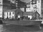 PT-211, a Higgins 78-footer of Motor Torpedo Boat Squadron 15 (MTBRon 15) in Bastia harbor, Corsica, France, May 1944. Note the raised rocket launcher rails on the foredeck.