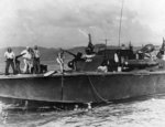 PT-321, an Elco 80-footer of Motor Torpedo Boat Squadron 21 (MTBRon 21), picking up Japanese survivors in Surigao Strait, Philippines, 25 Oct 1944