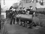Sailors aboard the Norwegian destroyer HNoMS Stord reloading the ship's torpedo tubes at Rosyth, Scotland, United Kingdom, Jan 1944.