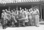 Colonel Louis P. Ely reading surrender terms of Major General Toshio Taga, Okinawa, Japan, 5 Sep 1945