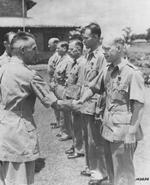 Lieutenant General Joseph Stilwell shaking hands with Captain John H. Grindley, who had just received a Purple Heart medal, India, mid-1942