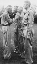 Lieutenant General Joseph Stilwell awarding the Purple Heart medal to Colonel Robert P. Williams, India, 1942