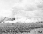 Fires burning at Henderson Field, Guadalcanal, Solomon Islands, Aug-Oct 1942
