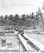 Jeep crossing a coconut tree log bridge over the Bonegi River, Guadalcanal, late 1942