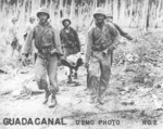 US Marines evacuating a wounded comrade, near Kokumbona River, Guadalcanal, Sep-Oct 1942