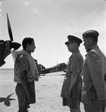 King George II of Greece speaking to a pilot of No. 335 (Hellenic) Squadron RAF at LG 20/Qotafiya, Egypt, 1942; note squadron commander Major X. F. Varvaresos