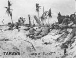 US Marines in prone position on the landing beach at Tarawa, Gilbert Islands, 20 Nov 1943, photo 2 of 2