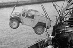 Canadian-built CMP Field Artillery Tractor being unloaded from a troop ship in Colombo harbor, Ceylon (now Sri Lanka), Feb 1942.